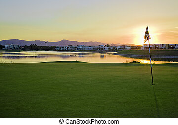 Golf Course at Sunset - Golf Course with sun setting over...