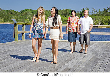 family walking on viewing platform by the creek