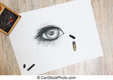Human eye is drawn in charcoal on paper. - The human eye is...