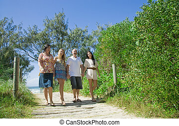 family walking from the beach talking and giggeling - family...