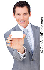 Attractive businessman holiding a business card against a...