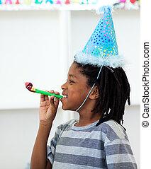 Jolly boy having fun at a birthday party at home