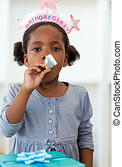 Portrait of a little girl at her birthday party