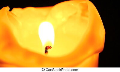 Closeup of a burning candle