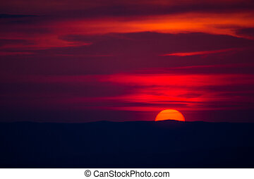 disk of the sun goes below the horizon - red disk of the sun...