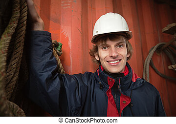 Young worker in white hardhat - Smiling worker in hardhat...