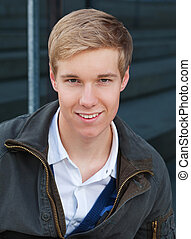 Handsome young blond man - Portrait of smiling blond...