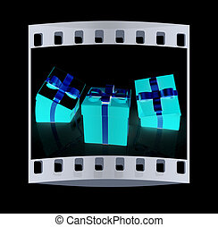 Crumpled gifts The film strip - Crumpled gifts on a black...