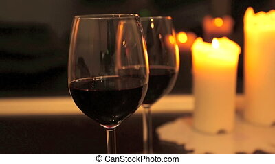 Two glasses of wine with candles