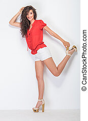 sexy young woman holding her leg up