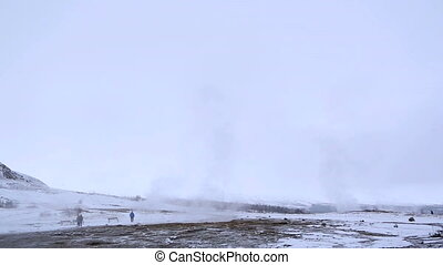 Geyser eruption of Strokkur - Visitors at the geyser...