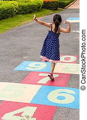 Girl Playing Hopscotch / Girl Playing Hopscotch on...