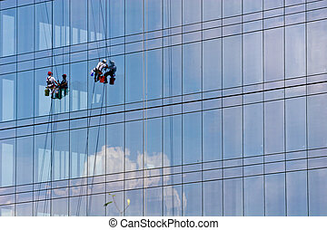 Window Washers on Building with Cloud Reflection - Two...