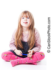 Little girl sit with stick her tongue out - Happy little...
