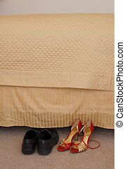 Bedside Shoes - One pair of ladies and mans shoes at bedside...