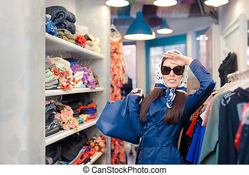 Happy Girl in Trench Coat Shopping - Retro young woman in a...