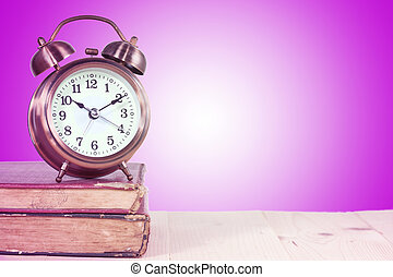 clock on the old book with color background