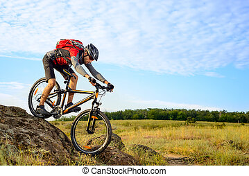 Cyclist Riding the Bike Down Rocky Hill. Extreme Sport...