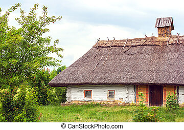 Ukrainian hut thatched sloping field near