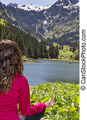 Woman in prayers pose outdoor in nature - Rearview of a yogi...