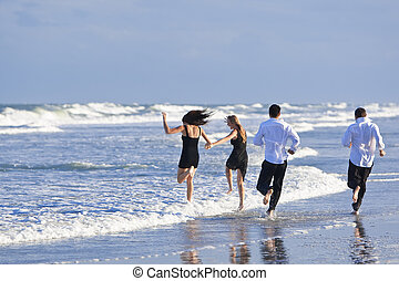 Four Young People, Two Couples, Having Fun On A Beach - Four...