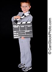 Boy Businessman - Young boy dressed formally wearing a suit...
