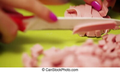 Cutting dairy sausages
