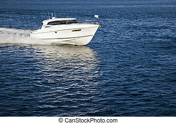 White motor boat sailing in calm water