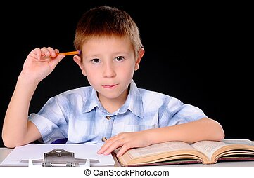 The Student - Young boy hard at work studying his books