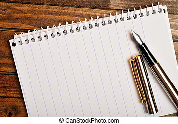 Empty notepad with fountain pen