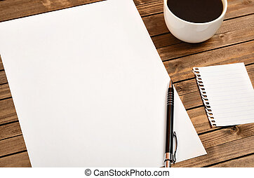 White paper with cup of coffee