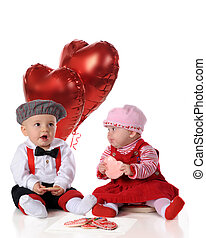 Valentine Day Snacks - A baby girl and boy, dressed for a...
