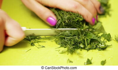 Cutting of dill on salad - On plastic chalkboard girl with...