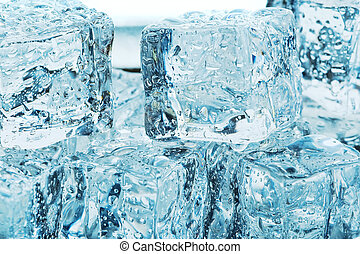 Ice melt - A bunch of melting blue ice cubes
