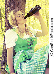 Oktoberfest girl drinking beer - Oktoberfest german girl...