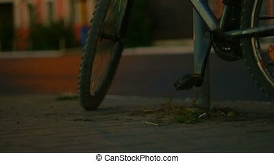 Mountain bicycle in night city We can see blurred car...