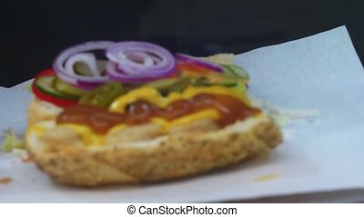 Adding souce in fast food sandwich - Chief preparing...
