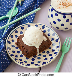 Brownie a la mode - Chocolate brownie a la mode and a cup of...