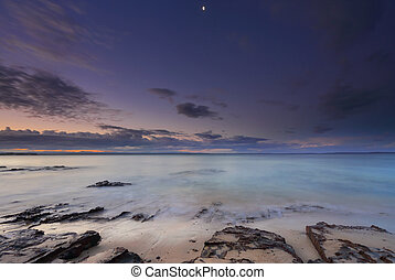 Tranquil moments at dusk on the beach in Jervis Bay -...
