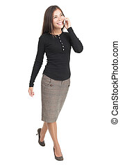 Businesswoman isolated walking in full length with mobile...
