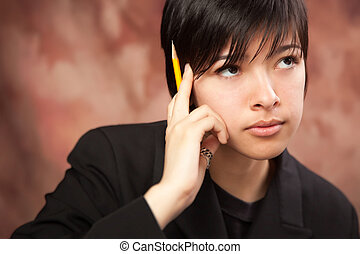 Multiethnic Girl Ponders While Holding Pencil - Multiethnic...