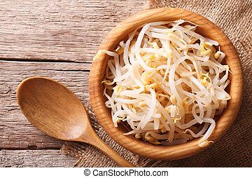 sprouts of mung beans in a wooden bowl horizontal top view -...