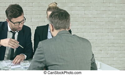 Disagreeing with colleagues - Business team discussing...