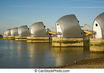Thames Barrier at sunset against a clear blue sky
