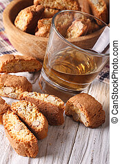 Italian almond biscotti cookies and wine close-up. vertical...