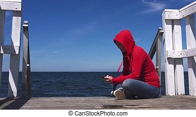 Young woman texting on mobile phone - Young woman texting...