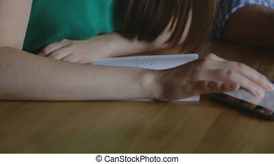Young couple working with the tablet and writes in a...