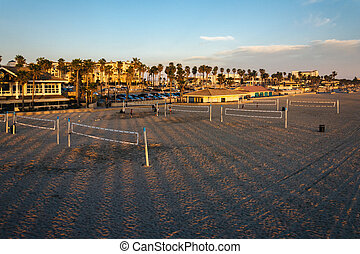 View of the beach at sunset, in Huntington Beach, California.