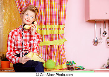 chatter - Pretty teen girl talking on the phone on a pink...