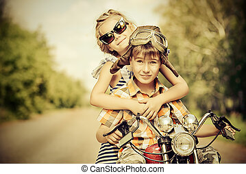 traveller - Happy kids go on a journey on a motorcycle on a...